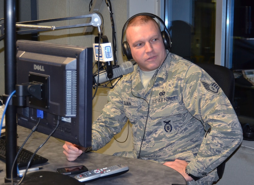 Oregon Air National Guard Staff Sgt. Kylan Olsen, 142nd Fighter Wing Security Forces Squadron, is interviewed live on the radio during the Bob Miller Show, as part of Operation Santa Claus, here in Portland, Ore., Nov. 30, 2012. (U.S. Air Force photo by Tech. Sgt. Emily Thompson, 142nd Fighter Wing Public Affairs/Released)