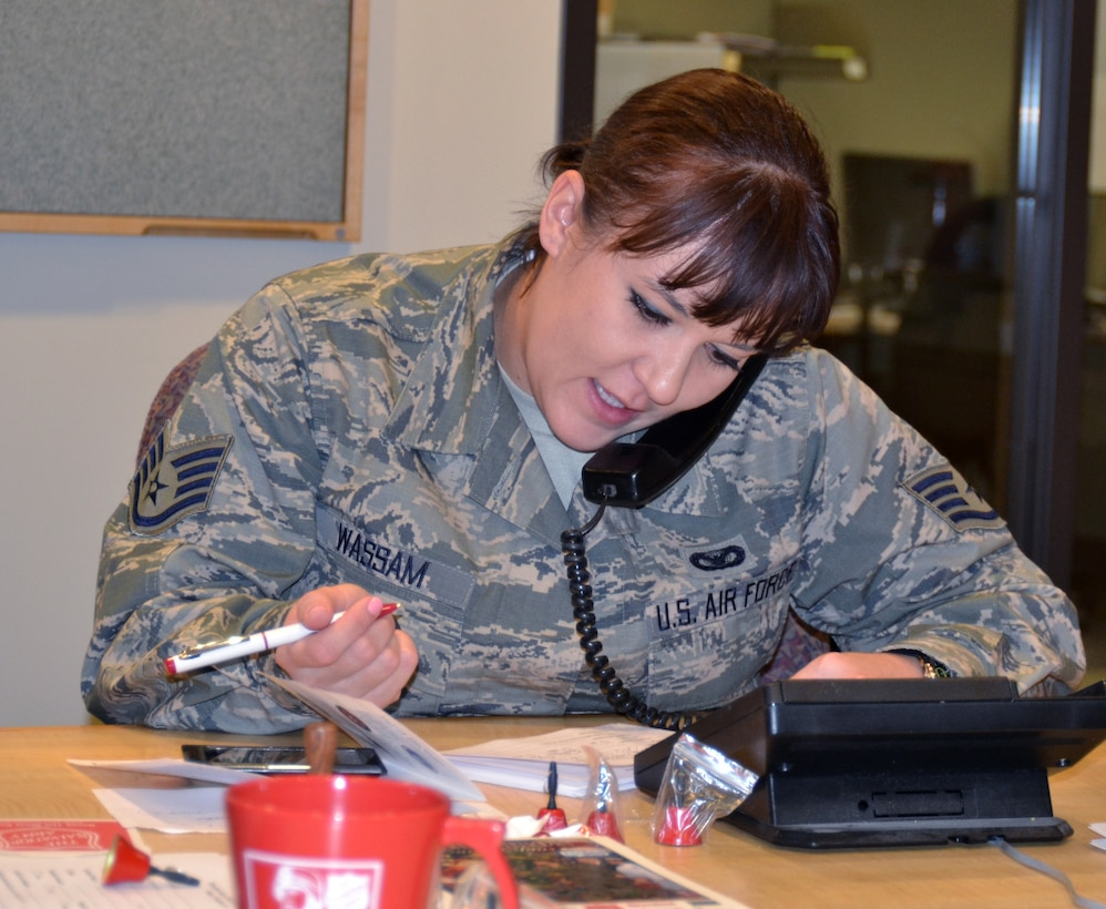 Oregon Air National Guard Staff Sgt. Sara Wassam, 142nd Fighter Wing Security Forces Squadron, takes a fund raising pledge over the phone as part of the Operation Santa Claus, during the Bob Miller Show on KAMP, AM-860 radio, here in Portland, Ore., Nov. 30, 2012. (U.S. Air Force photo by Tech. Sgt. Emily Thompson, 142nd Fighter Wing Public Affairs/Released)