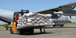 Marine Corps KC-130J Hercules aircraft carrying relief goods from Manila arrives in Davao City. U.S. Marine Forces Pacific Command has sent personnel and supplies to transport loads of humanitarian assistance and disaster relief supplies via C-130 aircraft. Two C-130's arrived in Manila from Okinawa on Saturday. U.S. and Philippine military personnel worked side by side to load the first C-130 flight that carried relief supplies to Davao yesterday. The Marines and aircraft are with Marine Aerial Refueler Transport Squadron 152, Marine Aircraft Group 36, 1st Marine Aircraft Wing, III MEF.