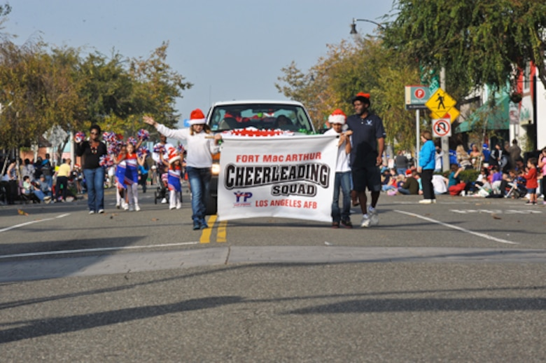 The Fort MacArthur Cheerleading Squad marches in the El Segundo Holiday Parade, Dec. 9.  (Photo by Sarah Corrice)