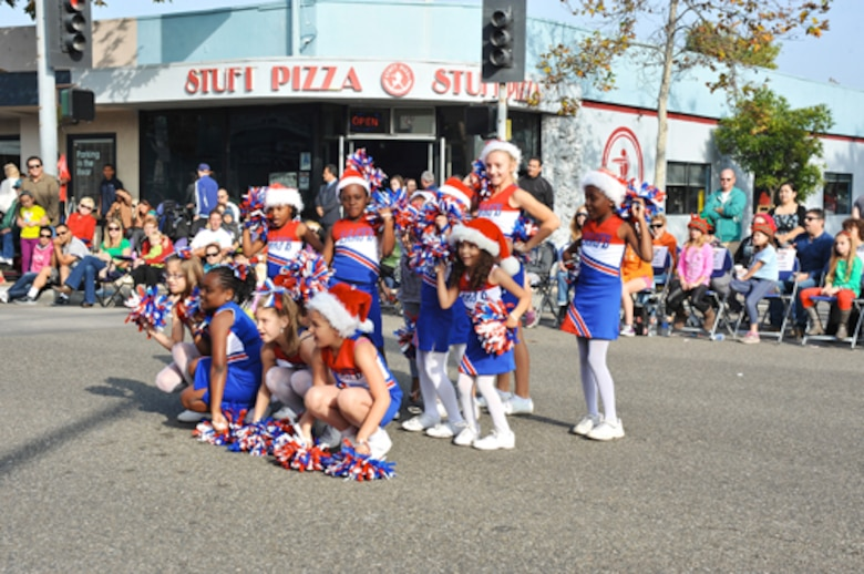 The Fort MacArthur Cheerleading Squad performs a cheer during the El Segundo Holiday Parade, Dec. 9.  (Photo by Sarah Corrice)