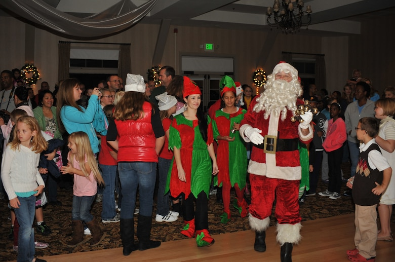 Santa Claus and his elves arrive for the annual base tree lighting, Nov. 30. Featuring music, food and a visit from St. Nick, the event kicks off the holidays at Los Angeles AFB. (Photo by Sarah Corrice)