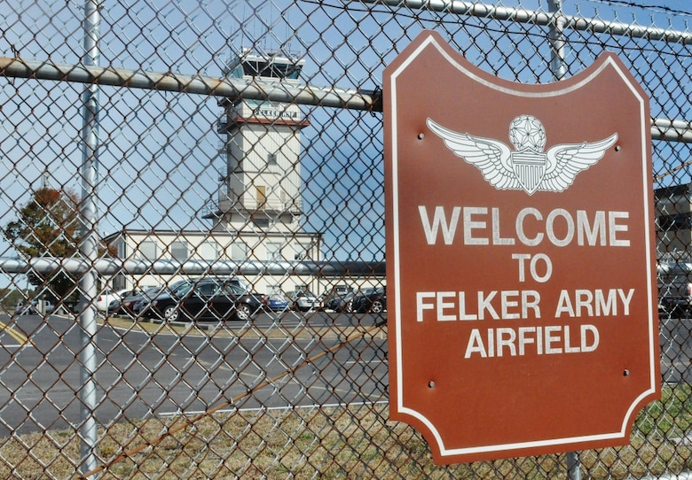 The air traffic control tower is seen through the flightline gate at Felker Army Airfield at Fort Eustis, Va., Nov. 7, 2012. Felker opened Dec. 10, 1954 as Felker Heliport, becoming the first military heliport in the world. (U.S. Air Force photo by Senior Airman Jason J. Brown/Released)