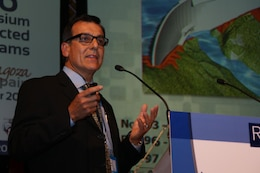 Alberto Gonzalez, Portugues Dam project manager, makes a point while speaking about the transition to a Roller Compacted Concrete Dam during a presentation at a conference in Zaragoza, Spain.  Gonzalez was one of three Jacksonville District representatives who participated.  Photo courtesy Alberto Gonzalez.
