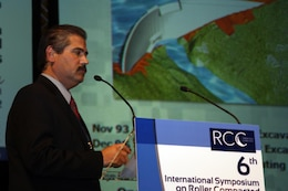 Pablo Vázquez-Ruiz, Portugues Dam resident engineer, gives a presentation at the Sixth International Symposium on Roller Compacted Concrete Dams in Zaragoza, Spain. Along with Project Manager Alberto Gonzalez and Geologist John Conway, Vázquez-Ruiz discussed successes and challenges in the design and construction of the dam, located near Ponce, Puerto Rico. Photo courtesy Pablo Vázquez-Ruiz.