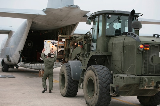 Marines load a KC-130J Hercules aircraft at Marine Corps Air Station Futenma bound for the Republic of the Philippines Dec. 8 to assist in humanitarian assistance and disaster relief efforts in the wake of Typhoon Bopha. The aircraft provides the lift capacity and capability to transport personnel and relief supplies to areas where they are needed. Personnel with 3rd Marine Expeditionary Brigade, already located in the Philippines and serving as the III Marine Expeditionary Force Forward Command Element, will help provide assistance as requested to areas affected by the typhoon in support of ongoing relief efforts by the Government of the Republic of the Philippines, the Armed Forces of the Philippines and the U.S. Agency for International Development. The aircraft and Marines are with Marine Aerial Refueler Transport Squadron 152, Marine Aircraft Group 36, 1st Marine Aircraft Wing, III MEF. (U.S. Marine Corps photo by Lance Cpl. Matthew Manning/Released)