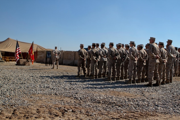 Marines and sailors with India Company, 3rd Battalion, 9th Marine Regiment, Regimental Combat Team 7, stand silently at parade rest during the beginning of a memorial service in honor of Lance Cpl. Anthony Denier, Dec. 8, 2012. Denier, a rifleman with the battalion, died while conducting combat operations in Marjah, Afghanistan, Dec. 2, 2012.