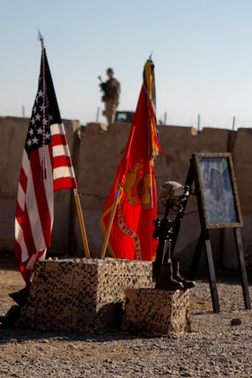 A Marine stands post during a memorial service honoring Lance Cpl. Anthony Denier, Dec. 8, 2012. Denier, a rifleman with India Company, 3rd Battalion, 9th Marine Regiment, Regimental Combat Team 7, died while conducting combat operations in Marjah, Afghanistan, Dec. 2, 2012.
