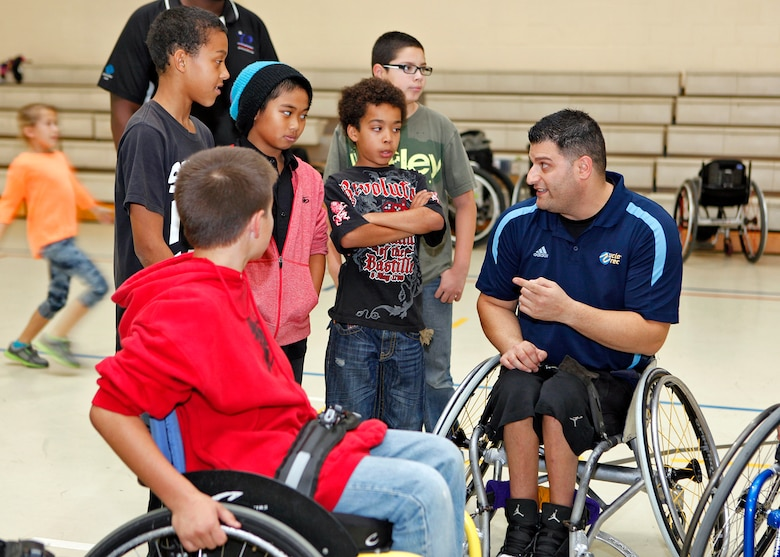 Michael Garafola, UCLA Adaptive Recreation volunteer, was one of the many ambassadors with the Triumph Foundation who were on hand to teach Edwards Youth Center members about adaptive sports during an an adapted sports clinic Dec. 6, 2012. (U.S. Air Force photo by Jet Fabara)