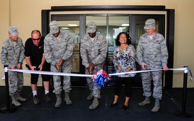 ANDERSEN AIR FORCE BASE, Guam -- Leadership from the 36th Wing and 36th Force Support Squadron personnel cut the ceremonial ribbon at the opening of the new Arts and Crafts Center on Andersen Air Force Base, Guam, Dec. 7, 2012. The store is now located in the Plaza Arcade across the Gecko Lanes bowling center. (U.S. Air Force photo/Airman 1st Class Marianique Santos/Released)