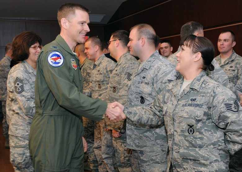 Oregon Air National Guard Col. Rick Wedan, 142nd Fighter Wing Commander shakes hands with Oregon Air National Guard Staff Sgt. Sara J. Wassam, 142nd Fighter Wing Security Forces Squadron during the mobilization ceremony for the 142nd Fighter Wing Security Forces Squadron at Camp Withycombe, Ore., Dec. 11, 2012. (U.S. Air Force photograph by Tech. Sgt. John Hughel, 142nd Fighter Wing Public Affairs/Released)