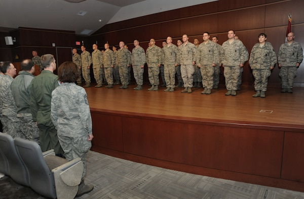 Oregon Air National Guard senior leaders stand (to the left) as they acknowledge members of the 142nd Fighter Wing Security Forces during the mobilization ceremony for the 142nd Fighter Wing Security Forces Squadron at Camp Withycombe, Ore., Dec. 11, 2012. (U.S. Air Force photograph by Tech. Sgt. John Hughel, 142nd Fighter Wing Public Affairs/Released)