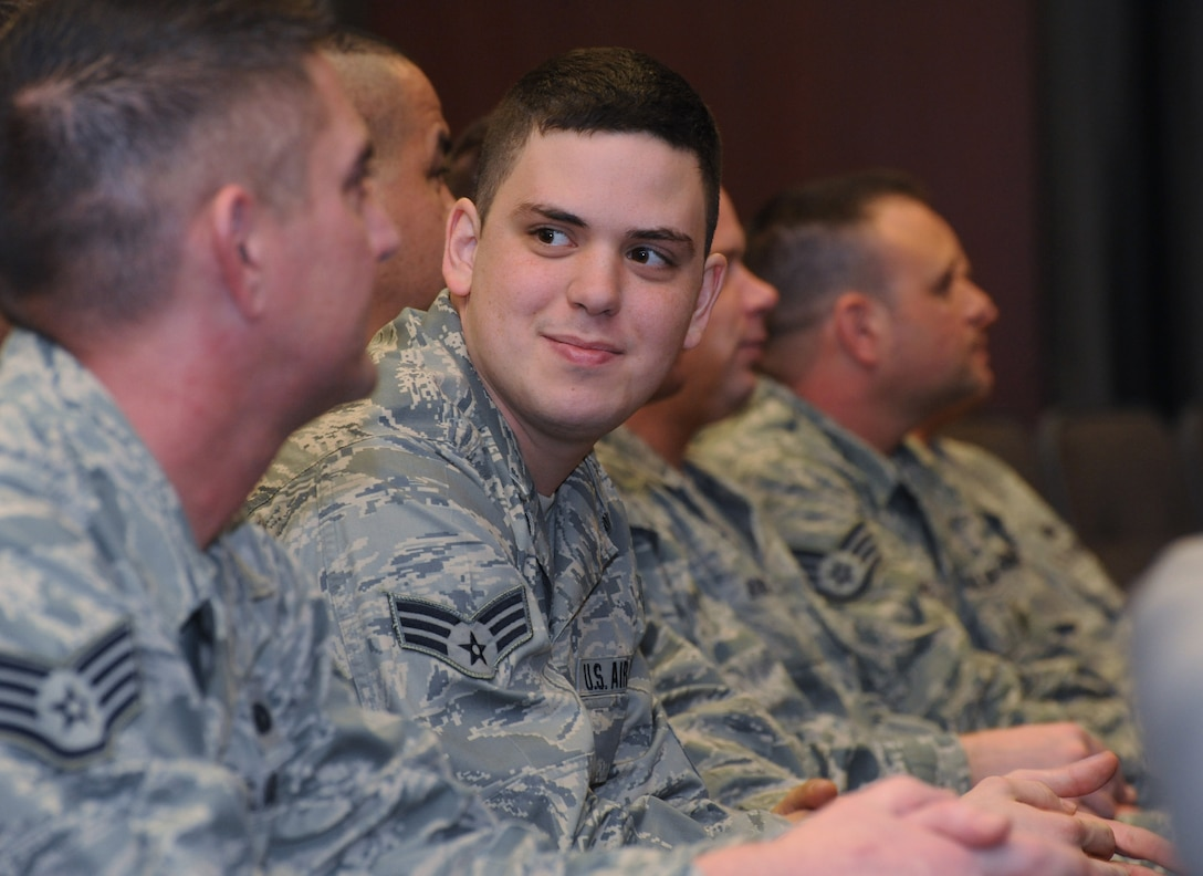 Oregon Air National Guard Senior Airman James A. Kalmbach, 142nd Fighter Wing Security Forces Squadron, relaxes for a few moments with some of his fellow airmen, prior to the mobilization ceremony for the 142nd Fighter Wing Security Forces Squadron at Camp Withycombe, Ore., Dec. 11, 2012. (U.S. Air Force photograph by Tech. Sgt. John Hughel, 142nd Fighter Wing Public Affairs/Released)