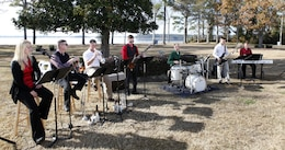 Members of the II Marine Aircraft Wing Band play live music for patrons at the Joint Holiday Reception aboard Marine Corps Base Camp Lejeune Dec. 1. The reception is hosted to give thanks for the combined cooperation of military personnel aboard the base and civilian personnel in the surrounding communities.