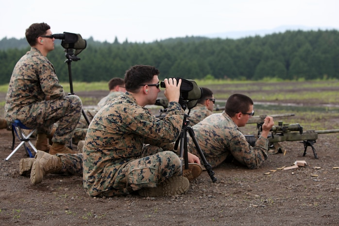 Marines with the Maritime Raid Force engage targets during rapid target engagement training, July 6. Snipers from the Amphibious Reconnaissance Platoon and Scout Snipers came together to train and provide a demonstration to Japanese Ground Self Defense Forces. The 31st MEU is the United States' force in readiness for the Asia Pacific.