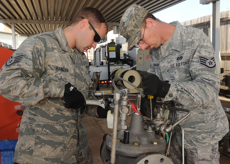 Staff Sgts. Daniel Hamden and Jeremy Coker, 2nd Civil Engineer Squadron water and fuels systems maintenance craftsmen rebuild a hydrant refueling control valve for large frame aircraft on Barksdale Air Force Base, La., Dec. 3. The hydrant can pump more than 400 gallons of fuel per minute into a B-52H Stratofortress. (U.S. Air Force photo/Senior Airman Kristin High)