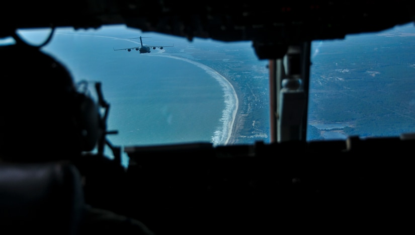 Two C-17 Globemaster IIIs, assigned to the 437th Airlift Wing at Joint Base Charleston, S.C., fly over the South Carolina Lowcountry coast during an incentive flight Dec. 6, 2012. More than 50 quarterly award winners attended an incentive flight involving two C-17s, which were conducting air drop training missions at JB Charleston's – North Auxiliary Air Field. (U.S. Air Force photo/ Airman 1st Class Jared Trimarchi)