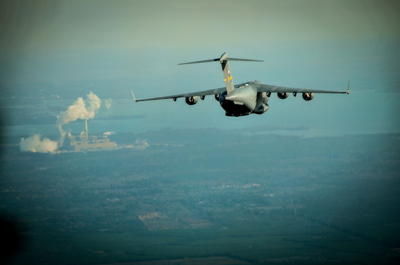 A C-17 Globemaster III, assigned to the 437th Airlift Wing at Joint Base Charleston, S.C., flies over the Lowcountry during an incentive flight, Dec. 6, 2012. More than 50 quarterly award winners attended an incentive flight involving two C-17s, which were conducting air drop training missions at JB Charleston's – North Auxiliary Air Field. (U.S. Air Force photo/ Airman 1st Class Jared Trimarchi)