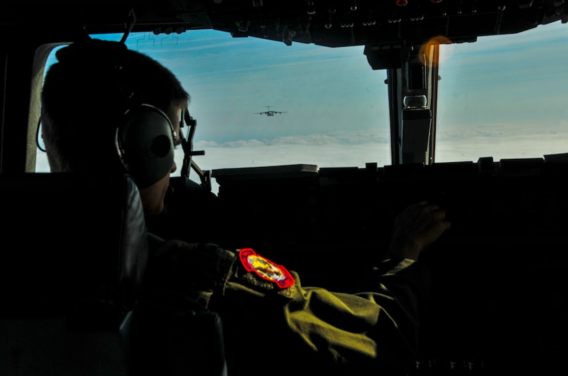 Capt. Brandon Dewey, 15th Airlift Squadron pilot, adjusts the heading of a C-17 Globemaster III during an incentive flight Dec. 6, 2012, over the Lowcountry of South Carolina. More than 50 quarterly award-winning Airmen and Sailors and civilians attended the incentive flight onboard two C-17s which were conducting an air drop training mission at Joint Base Charleston's – North Auxiliary Air Field. (U.S. Air Force photo/ Airman 1st Class Jared Trimarchi)