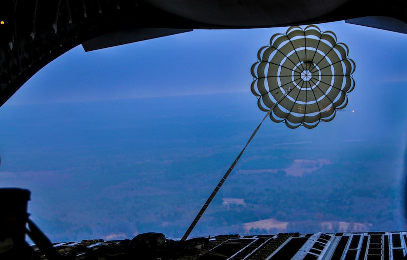 A parachute pulls a pallet out of the rear of C-17 Globemaster III from the 437th Airlift Wing at Joint Base Charleston – Air Base, S.C. The Dec. 6, 2012, mission also hosted an incentive flight and more than 50 JB Charleston quarterly award winners flew onboard two C-17s which were conducting air drop training missions at JB Charleston's – North Auxiliary Air Field. (U.S. Air Force photo/ Airman 1st Class Jared Trimarchi)