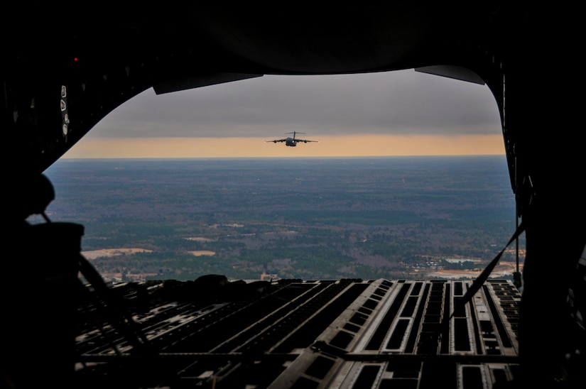 A C-17 Globemaster III, assigned to the 437th Airlift Wing at Joint Base Charleston – Air Base, soars above the Lowcountry during an incentive flight, Dec. 6, 2012.  More than 50 quarterly award winners attended the incentive flight onboard two C-17s, which were conducting air drop training missions at JB Charleston's – North Auxiliary Air Field. (U.S. Air Force photo/ Airman 1st Class Jared Trimarchi)