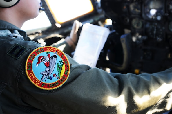 The Operation Christmas Drop 2012 patch is displayed on the arm of Capt. Anthony Felix, an instructor pilot from the 36th Airlift Squadron at Yokota Air Base, Japan, as he takes off to begin an OCD delivery flight from Andersen Air Force Base, Guam, Dec. 12, 2012.  Each year OCD provides aid to more than 30,000 islanders in Chuuk, Palau, Yap, Marshall Islands and Commonwealth of the Northern Mariana Islands. This year is the 61st anniversary of OCD, making it the longest running humanitarian mission in the world. In total, there are eight planned days of air drops, with 54 islands scheduled to receive humanitarian aid.  (U.S. Air Force photo by Senior Airman Carlin Leslie/Released)