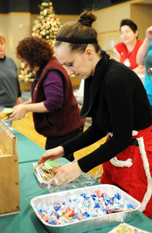 Jasmine Chandler, Cookie Caper volunteer, packages cookies during the base's annual Cookie Caper at Misawa Air Base, Japan, Dec. 11, 2012. Base community members and volunteers baked, donated and packaged a variety of cookies, which were delivered to single, unaccompanied servicemembers unable to spend the holiday season with their families. Each cookie tray included a holiday card from well-wishers. The event, sponsored by the Misawa Officers' and Enlisted Spouses' Clubs, gathered a total of 31,800 cookies. (U.S. Air Force photo by Airman 1st Class Kia Atkins)