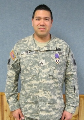 Sgt. Jay Silk, a Wounded Warrior in the Operation Warfighter program at the Tenkiller project office, was awarded the Purple Heart during a surprise ceremony.