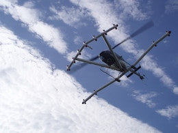 The helicopter magnetometer detects magnetic anomalies on the ground or in shallow surfaces. The device flies six feet above ground at speeds of 30 to 40 mph.