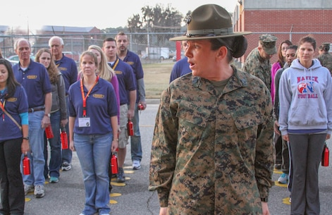 Staff Sgt. Jessica J. Cote, a drill instructor at Marine Corps Recruit Depot Parris Island, S.C., originally from Detroit, teaches basic drill to educators from the Harrisburg, Pa., and Portsmouth, N.H., areas during the first day of the Educator Workshop at MCRD Parris Island, Dec. 5.  The workshop brings together teachers, administrators and other education professionals aboard the depot and gives them the opportunity to experience what recruit training is like in the Corps.  (U.S. Marine Corps photo by Sgt. Bryan Lett)