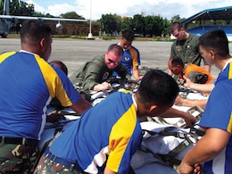 Philippine Air Force members and U.S. Marines load family ration packs Dec. 11 at Villamor Air Base in Manila during humanitarian assistance and disaster relief operations. The Marines transported the supplies via KC-130J Hercules aircraft to Davao International Airport for further distribution to citizens in need throughout Mindanao, the region of the Philippines most affected by Typhoon Bopha, which made landfall Dec. 4. The U.S. Marines are with Marine Aerial Refueler Transport Squadron 152, Marine Aircraft Group 36, 1st Marine Aircraft Wing, III Marine Expeditionary Force.