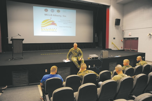 Col. Don Davis, commanding officer, Marine Corps Logistics Base Albany, discusses the Resident Energy Conservation Program for base housing with Marines and family members during a town hall meeting at the Base Theater, Dec. 4.