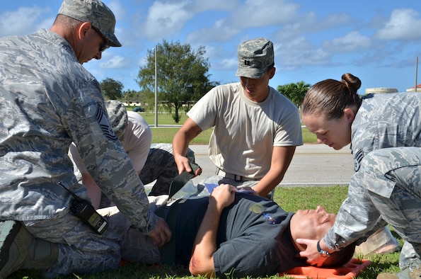 ANDERSEN AIR FORCE BASE, Guam--Medical responders stabilize a simulated neck injury victim during the Expeditionary Medical Support Health Response Team training on Andersen Air Force Base, Guam, Dec. 12, 2012. The exercise focused on mass-casualty training scenarios and humanitarian aid in response to crisis situations. During the weeklong exercise, medical Airmen from Joint Base Elmendorf-Richardson, Alaska, Yokota Air Base, Japan and Andersen worked together in setting up and training in the EMEDS HRT tents.( U.S. Air Force Photo by Staff Sgt. Alexandre Montes/Released)