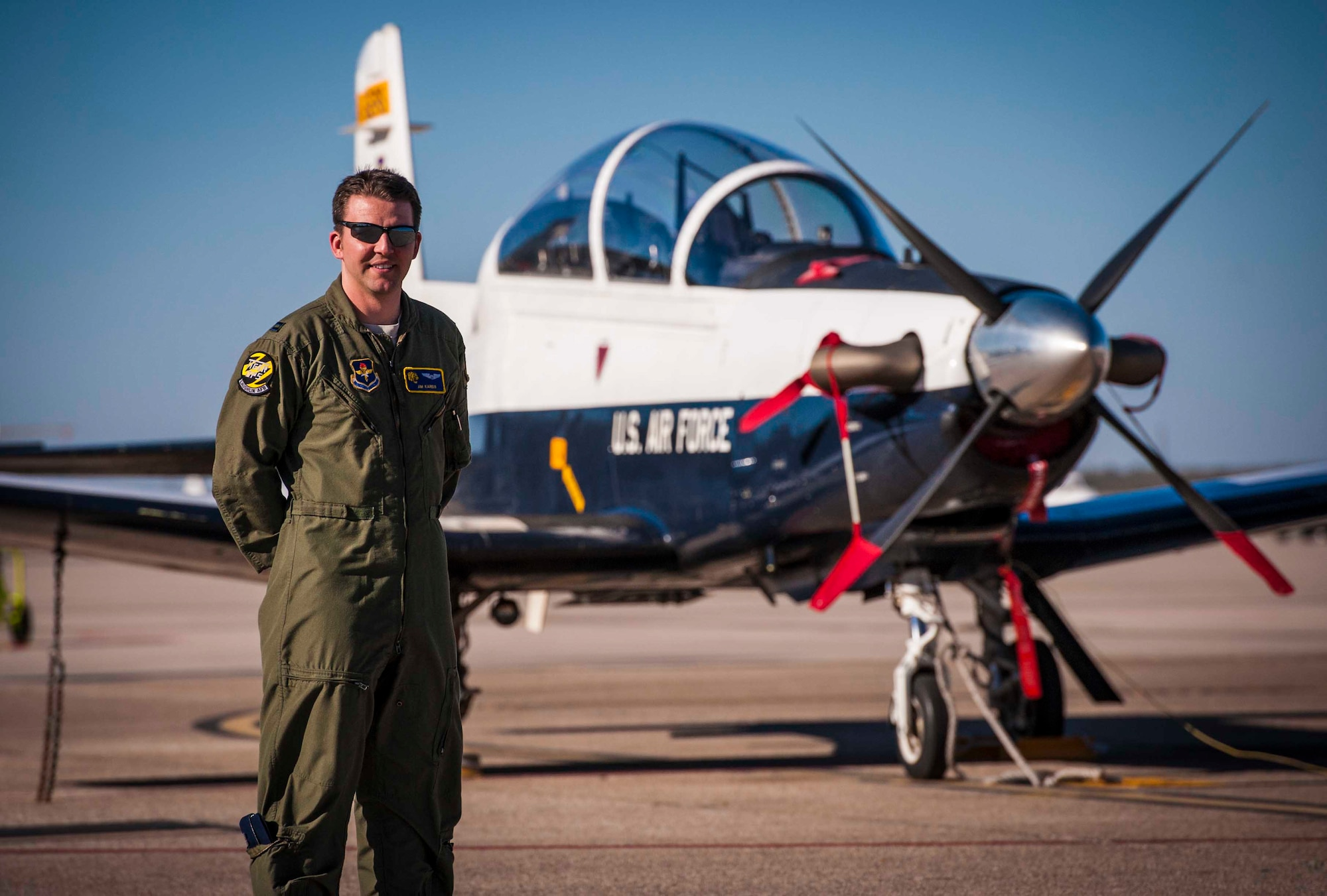 Air Force Capt. James Kareis, 85th Flying Training Squadron instructor pilot, poses for a picture in front of a T-6A Texan II aircraft at Laughlin Air Force Base, Texas, Dec. 12, 2012. During a routine return flight from Fort Worth Alliance Airport, he heard distress calls from an aircraft experiencing engine malfunctions and acted as a liaison between the aircraft and air traffic controllers in Houston, Texas. Kareis helped to ensure responders had accurate coordinates of his location after landing in a field safely. (U.S. Air Force photo/Senior Airman Scott Saldukas)