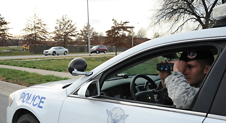 A security forces patrolman uses radar to ensure members of the community are within