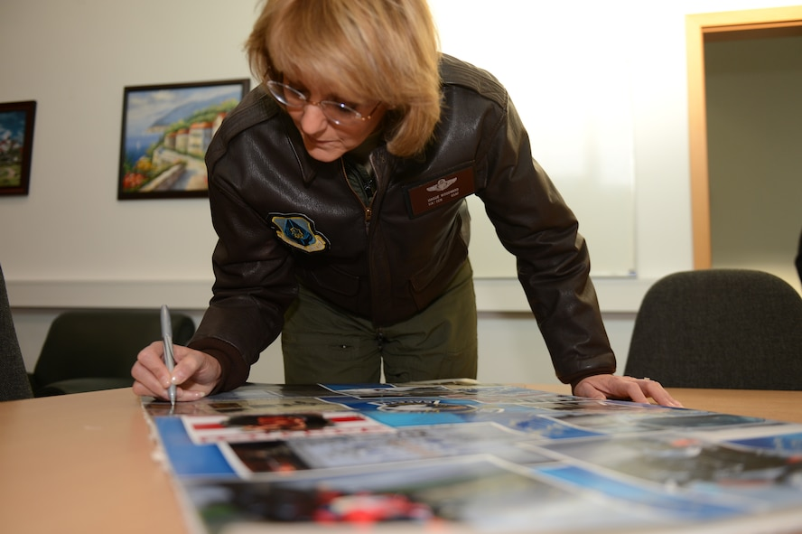 SPANGDAHLEM AIR BASE, Germany – U.S. Air Force Maj. Gen. Margaret Woodward, Air Force Chief of Safety, signs a safety poster inside the 52nd Fighter Wing Safety office Dec. 12, 2012. Woodward visited Spangdahlem to experience firsthand the safety office's vision, values and mission. (U.S. Air Force photo by Airman 1st Class Gustavo Castillo/Released)