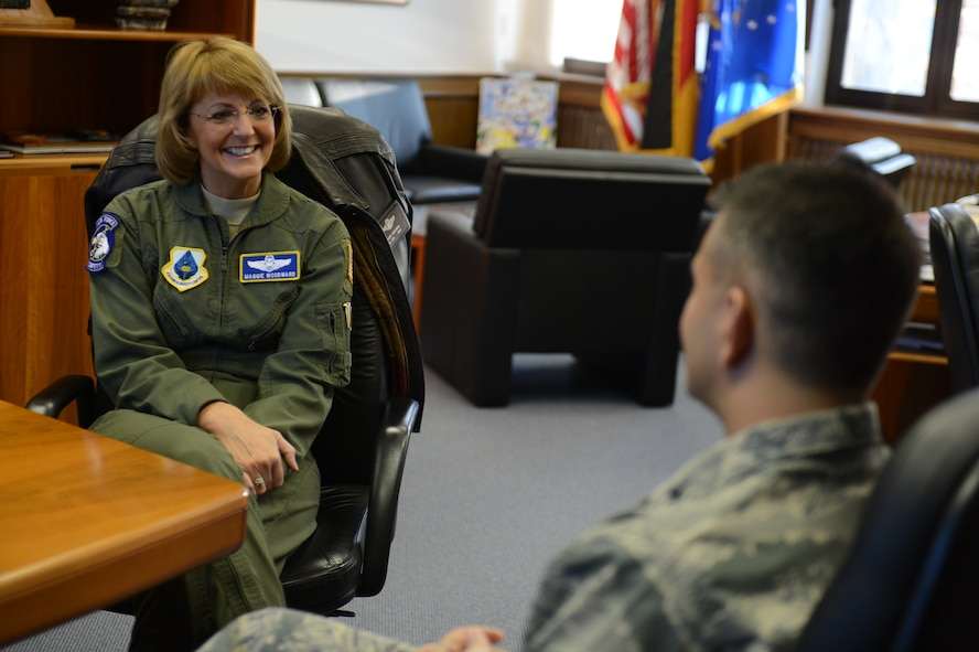 SPANGDAHLEM AIR BASE, Germany – U.S. Air Force Maj. Gen. Margaret Woodward, Air Force Chief of Safety, speaks with Col. David Julazadeh, 52nd Fighter Wing commander, in the 52nd FW headquarters building Dec. 12, 2012. Woodward toured Spangdahlem AB to familiarize herself with daily 52nd FW safety operations. (U.S. Air Force photo by Airman 1st Class Gustavo Castillo/Released)