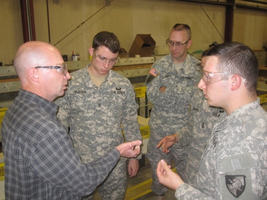 Members of the ERDC/West Point SIP-Hut team discuss material requirements for experimental and objective line research.