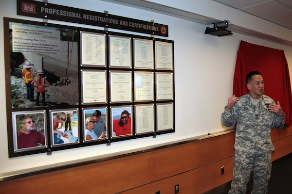 District Commander Col. Mark Toy unveiled two display boards Dec. 13 in the 12th floor conference room here. One for professional registrations and certifications and one for individual and organizational awards and recognition.