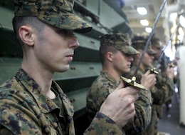 Cpl. Christopher Bennett, left, a native of Monroe, Conn., and Marine Air-Ground Task Force planner with the 24th Marine Expeditionary Unit, practices sword manual during Corporals Course Class 014-13 aboard the USS New York, Dec. 4, 2012. The 24th Marine Expeditionary Unit is deployed with the Iwo Jima Amphibious Ready Group in the 6th Fleet area of responsibility serving as an expeditionary crisis response force capable of a variety of missions from full-scale combat to evacuations and humanitarian assistance.