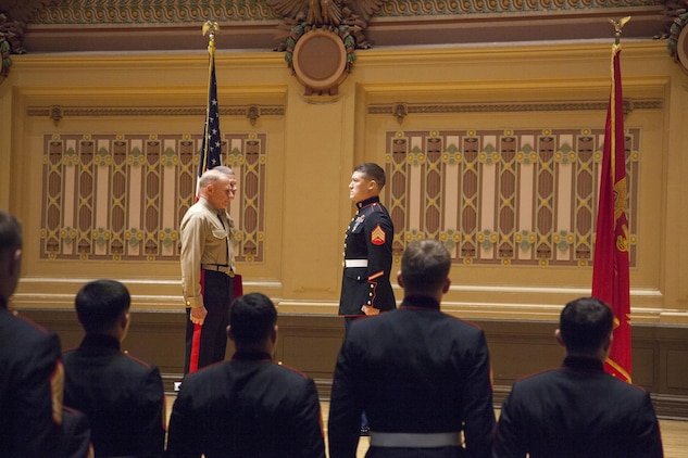 Cpl. David M. Gerardi recieves the Silver Star from Maj. Gen. Melvin Spiese, commanding general of 1st Marine Expeditionary Brigade Dec. 10, for his actions while deployed to Afghanistan.