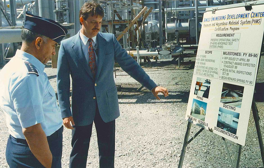 Bob Walker (right), Arnold Engineering Development Complex's (AEDC) civil engineering branch technical director, discusses the Pressure and Hazardous Material System in 1989 to four-star General Bernard Randolph. (Photo provided by Bob Walker)
