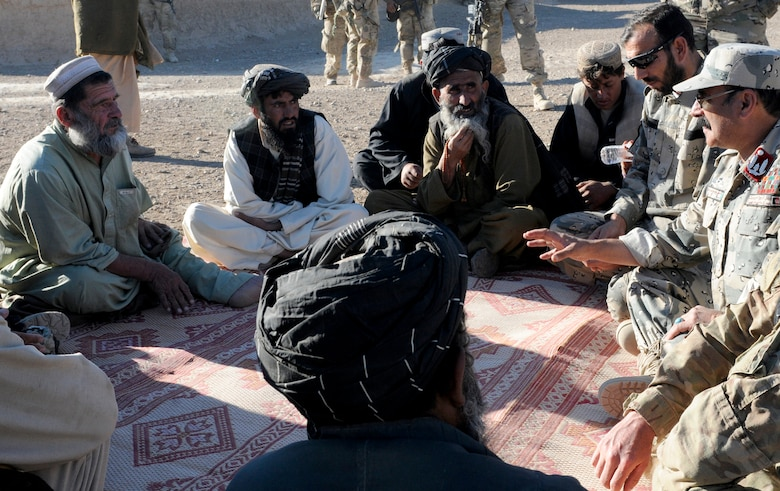 Maj. Asmatulla Safi (upper right), an operations officer with 3rd Zone Afghan Border Police and Col. Fasil Karim Karimi (on right with hat), chief of staff for 3rd Zone Afghan Border Police, speak with villagers of Gagre Naw, Afghanistan, during Operation Southern Strike IV, Nov. 18, 2012. (U.S. Army Photo/Staff Sgt. Ryan Sheldon)