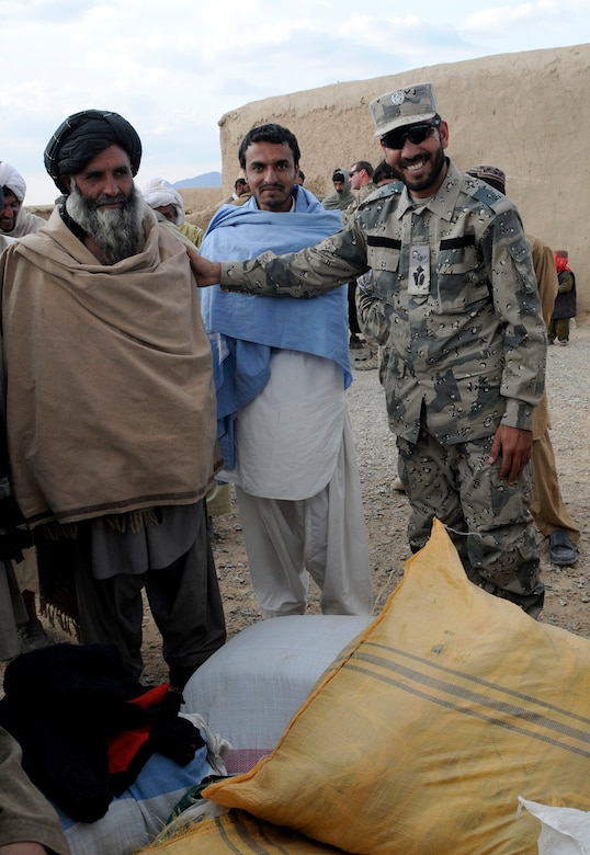 Maj. Asmatulla Safi (right), an operations officer with 3rd Zone Afghan Border Police poses with a village elder in Mawlazay, Afghanistan, during Operation Southern Strike IV, Nov. 17, 2012. More than 4,400 pounds of flour, rice, blankets and clothing were delivered to remote villages in Spin Boldak and Tak-the Pol Districts by Afghan Air Force Kandahar Air Wing Mi-17 helicopter crew members and the Afghan Border Police. (U.S. Army Photo/Staff Sgt. Ryan Sheldon)