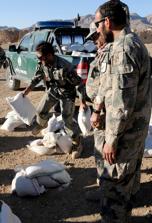 Members of the 3rd Zone Afghan Border Police separate humanitarian aid for the villagers of Gagre Naw, Afghanistan, during Operation Southern Strike IV, Nov. 18, 2012. (U.S. Army Photo/Staff Sgt. Ryan Sheldon)