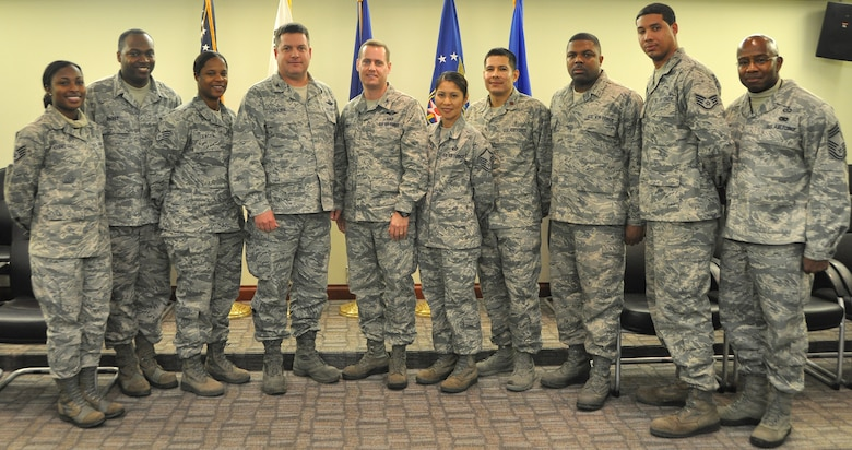 Osan leaders pose for a photo with the NCOs who went above and beyond to help a fellow Airmen with a personal battle. The eight NCOs were coined for their exemplary service Dec. 12, 2012 in the 7th Air Force conference room.  (U.S. Air Force photo/Senior Airman Kristina Overton)