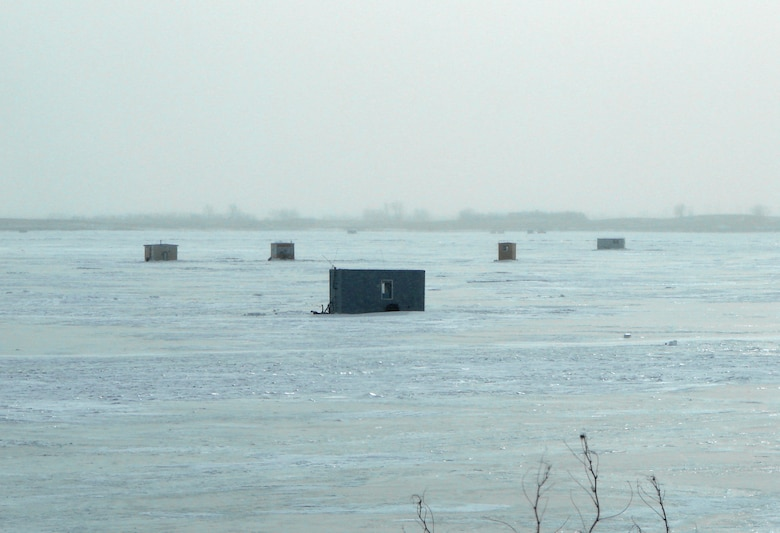 Each winter, as the temperatures drop and the ice thickens, fisherman set up temporary structrues on Lake Sakakawea to support fishing on the ice.