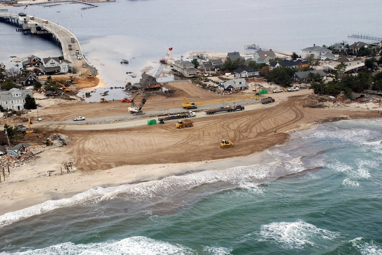 The U.S. Army Corps of Engineers worked rapidly to repair a levee breach caused by Hurricane Sandy in Mantoloking, N.J. The breach occurred at the end of the only bridge onto the barrier island, effectively cuting it off from the rest of the state. At the peak of the response effort, the Corps had nearly 4,000 employees from across the nation engaged in more than 38 FEMA mission assignments, exceeding a total of $134 million. (PHOTO BY MARY MARKOS, ST.LOUIS DISTRICT) (Photo by MARY MARKOS)