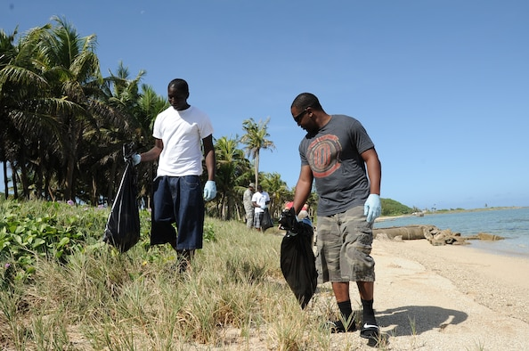 Airman 1st Class Gregory Jones-Fields, (left), and Airman 1st Class Keith Kennedy, both weapons personnel from the 36th Maintenance Squadron, participate in a beach cleanup at Asan Beach, Guam, Dec. 7, 2012, as part of their Weapons Day of Caring. The cleanup was organized in remembrance of the attacks on Pearl Harbor Dec. 7, 1941. (U.S. Air  Force photo by Airman 1st Class Adarius Petty/Released)