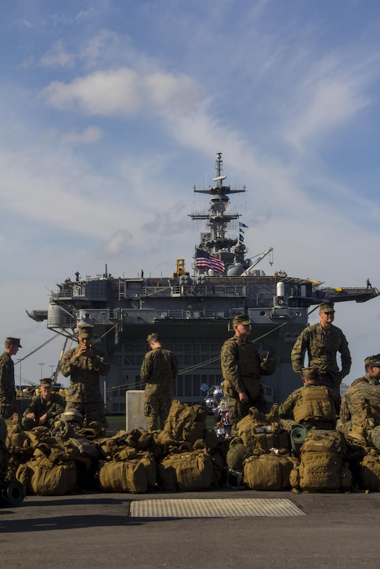 The Marines and sailors of the 26th Marine Expeditionary Unit (MEU) disembark from the USS Wasp (LHD-1) at Naval Station Norfolk, Va., after supporting disaster relief operations in New York in the aftermath of Hurricane Sandy, Nov. 12, 2012. The 26th MEU is able to provide generators, fuel, clean water, and helicopter lift capabilities to aid in disaster relief efforts. The 26th MEU is currently conducting pre-deployment training, preparing for their departure in 2013. As an expeditionary force operating from the sea the MEU is a Marine Air-Ground Task Force capable of conducting amphibious operations, crisis response, and limited contingency operations.